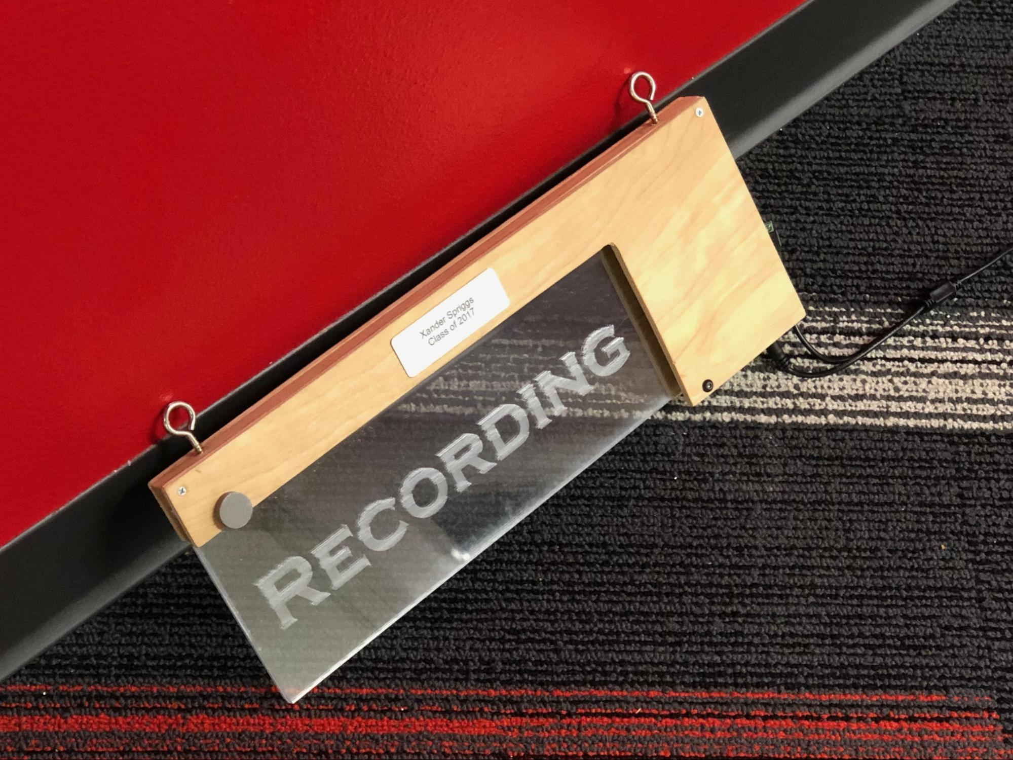 student recording sign created in STEM engineering class