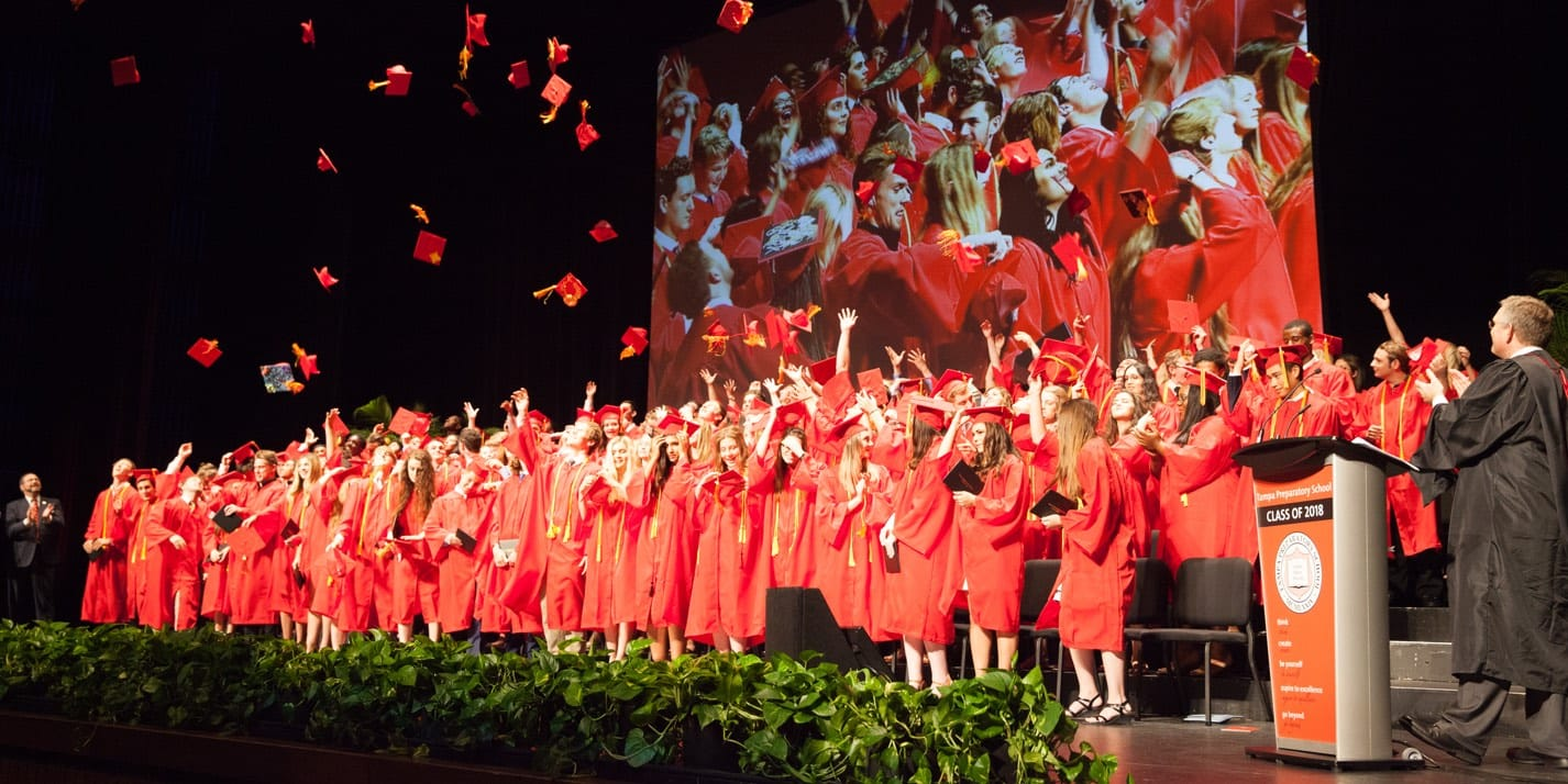 Class of 2018 throwing caps in the air after Tampa Prep graduation