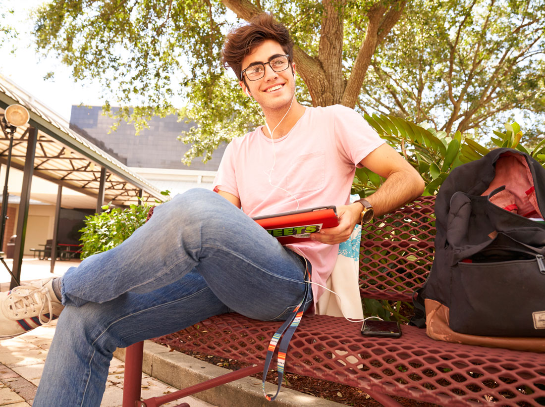 Boy studying in courtyard at Tampa Prep