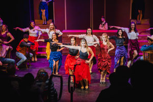 Students dancing on stage during Curtains the Musical